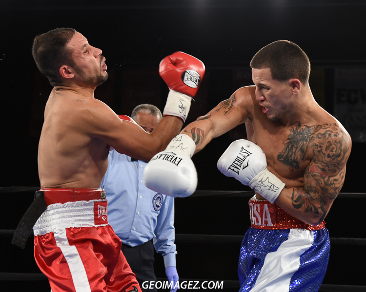 Sosa (blue trunks) lands a right hand