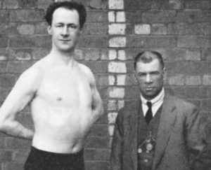 Dai Dollings (R) with one of his fighters.