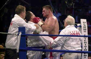 20 Oct 2000: Andrew Golota fights with his corner prior to the third round of his Heavyweight fight against Mike Tyson at the Palace of Auburn Hills, Michigan. Tyson won by TKO in the third round after Golota refused to answer the bell. DIGITAL IMAGE. Mandatory Credit: M David Leeds/ALLSPORT