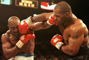 Evander Holyfield (L) and Mike Tyson (R) trade punches 28 June in their WBA heavyweight Cchampionship fight at the MGM Grand Garden Arena in Las Vegas, NV. Holyfield won by disqualification in the the third round after Tyson bit his ear.