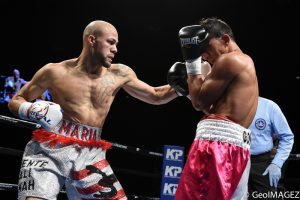 Cintron connects with a left hook – Photo by GeoIMAGEZ Photography