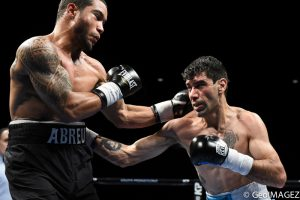 Peralta connects with a left hook to the body – Photo by GeoIMAGEZ Photography