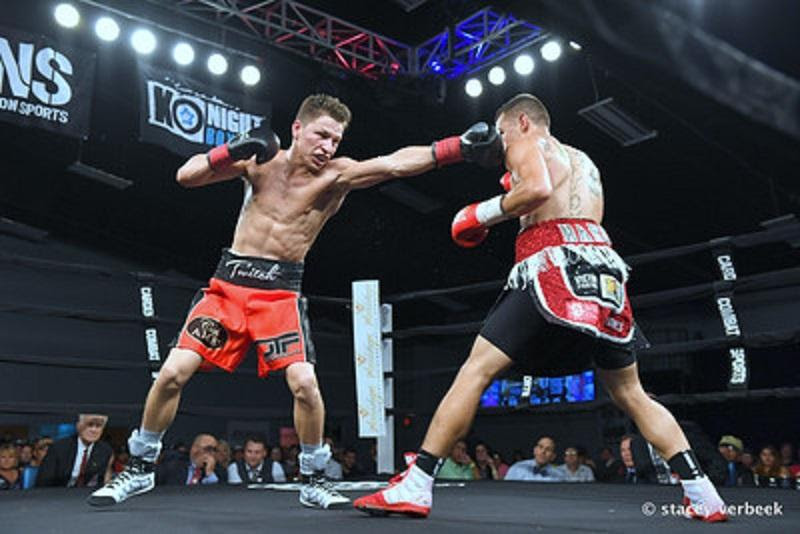 Jose Haro (L) captured the vacant USBA featherweight title