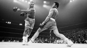 Boxer Ali Dodging a Punch From Frazier