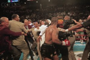 Trainers and Police Officers Attempting to Restrain Mike Tyson